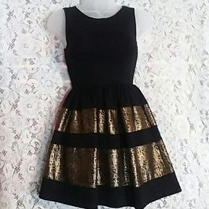 Perfect form fitting black and gold dress. NWOT
